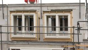 Baustelle mit dem Haus im Bau Lizenzfreie Stockfotografie
