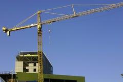 Baustelle u. der Kran Stockbilder