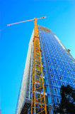 Baustelle-Wolkenkratzer und Kran Stockfotografie