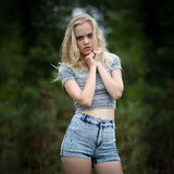 Bautiful Blond Teenage Girl Alone In The Woods Stock Image