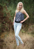 Bautiful Blond Teenage Girl Alone In The Woods Royalty Free Stock Photos