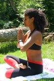 Bautiful brazilian woman in yogapose. Beautiful brazilian woman doing yogapose outdoors Stock Photo