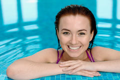 Bautiful girl in a swimming pool. Portrait of a smiling girl in a swimming pool Royalty Free Stock Photos