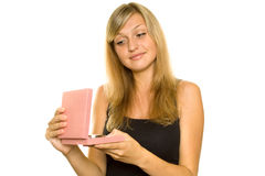 Bautiful young girl opens a gift box Stock Images