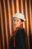 Bautifully dressed hispanic model wearing andean traditional clothing, matching white hat and black poncho on top, as Stock Photos