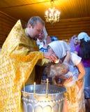 Bautismo en la iglesia cristiana Foto de archivo libre de regalías