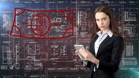 Bauty business woman standing in suit with Bitcoin Logo to illustrate the use of bitcoin for trading or money transfer. stock photos