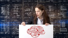 Bauty business woman standing in suit with Bitcoin Logo to illustrate the use of bitcoin for trading or money transfer. Royalty Free Stock Photos