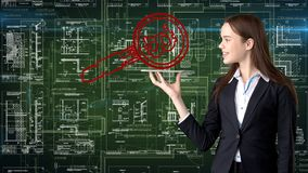 Bauty business woman standing in suit with Bitcoin Logo to illustrate the use of bitcoin for trading or money transfer. royalty free stock photo