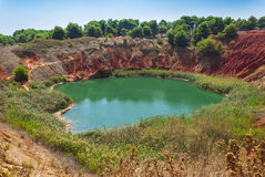 Bauxite lake in Italy Stock Photo