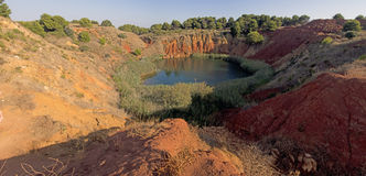 Bauxite Mine with Lake at   Otranto   Italy. Bauxite Mine with Lake at sunset,  Otranto   Italy panoramic view Stock Photos
