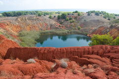 Bauxite mine and lake in Otranto Royalty Free Stock Image