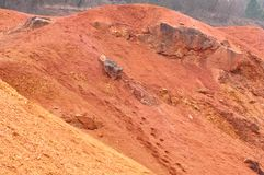 Bauxite mine raw bauxite on surface. Bauxite mine, raw weathered bauxite sedimentary rock on surface Royalty Free Stock Photography