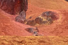 Bauxite mine raw bauxite on surface. Bauxite mine, raw weathered bauxite sedimentary rock on surface Royalty Free Stock Images
