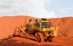 Bauxite mining. Piles of mining Bauxite in Weipa, Queensland, Australia Bauxite is an aluminium ore and is the main source of aluminium. Big bucket scoop Stock Photography