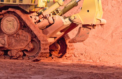 Bauxite mining. In Weipa, Queensland, Australia Bauxite is an aluminium ore and is the main source of aluminium. Big bucket scoop bulldozer mining technology Stock Photos