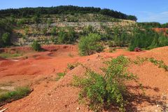 Bauxite. Old out of use open-pit bauxite mine in Gant Hungary with green vegetation Stock Photography