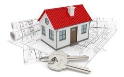 Bauzeichnungen und kleines Haus Stockbild