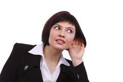 Bavardage de écoute de femme d'affaires Images stock