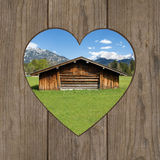 Bavaria. View of a Bavarian landscape through a wooden door with a heart Royalty Free Stock Photo