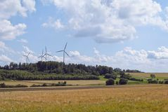 Bavaria. Germany. Field, sky and wind turbines Stock Images
