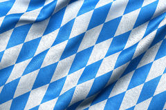 Bavaria flag. Highly detailed flag of Bavaria waving in the wind. Light blue sky is shining through the fabric texture Royalty Free Stock Image