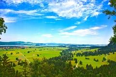 Bavaria landscape. Schwangau, Forggensee lake. Bavaria landscape from Neuschwanstein castle. Schwangau village and Forggensee lake on background Stock Image