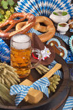 Bavaria and Oktoberfest. All typical German Bavarian symbols in one picture. Gingerbread heart, soft pretzels, Bavarian veal sausage and beer Stock Photo