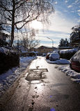 Bavaria, urban view with snow. Urban winter landscape with parked cars covered by snow Royalty Free Stock Image