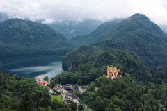 Bavarian Alps landscape, green forests and Hohenschwangau Castle Royalty Free Stock Photo