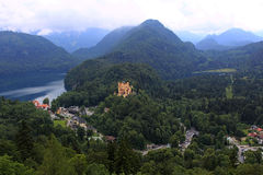 Bavarian Alps landscape, green forests and Hohenschwangau Castle Royalty Free Stock Photos