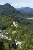 Bavarian Alps landscape, green forests and Hohenschwangau Castle Stock Image