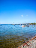 Bavarian Ammersee with boats on the lake Royalty Free Stock Image