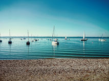 Bavarian Ammersee with boats on the lake Royalty Free Stock Photos