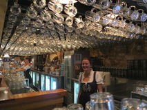 Bavarian pub interior with waitress. The bar of the popular restaurant Löwenbräu Keller - a Munich Brauhaus - in Sydney, Australia, with waitresses. The one in Royalty Free Stock Image