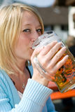 Bavarian Beer. Closeup of a woman drinking beer at the Oktoberfest in Bavaria (Munich Royalty Free Stock Image