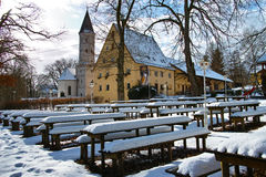 Bavarian beer garden in winter by snow Royalty Free Stock Photos