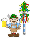 Bavarian with a beer and maypole Stock Photo