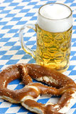 Bavarian Beer and Pretzel at Oktoberfest. Original Bavarian Oktoberfest Pretzel and Beer Stein (mug Royalty Free Stock Photo