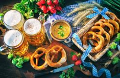 Bavarian beer with soft pretzels, obatzter and radish on rustic Royalty Free Stock Images
