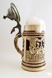Bavarian beer stein. On white Royalty Free Stock Photo