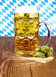Bavarian beer, wheat and hop on wooden background Stock Image