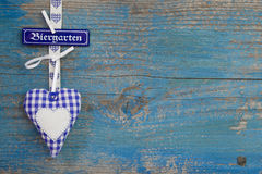 Bavarian blue wooden background with heart and text Stock Photo