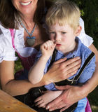 Bavarian boy with mother Royalty Free Stock Photography