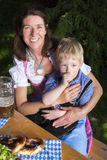 Bavarian boy with mother Royalty Free Stock Photo