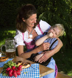 Bavarian boy with mother Stock Photo