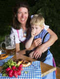 Bavarian boy with mother Stock Images