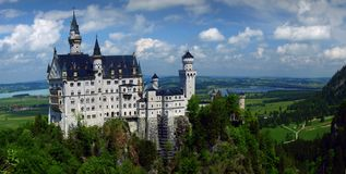Bavarian Castle - Neuschwanstein Castle. Panorama of Neuschwanstein Castle in Germany royalty free stock photo