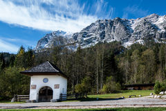 Bavarian Chapel in front of the Alp Mountains Royalty Free Stock Image