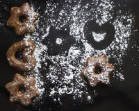 Bavarian cookies iced with sugar powder on the black background Stock Photos